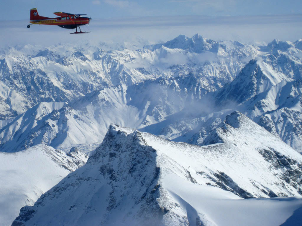 Jay Claus flies a Super Cub in formation over the Saint Elias Mountain Range