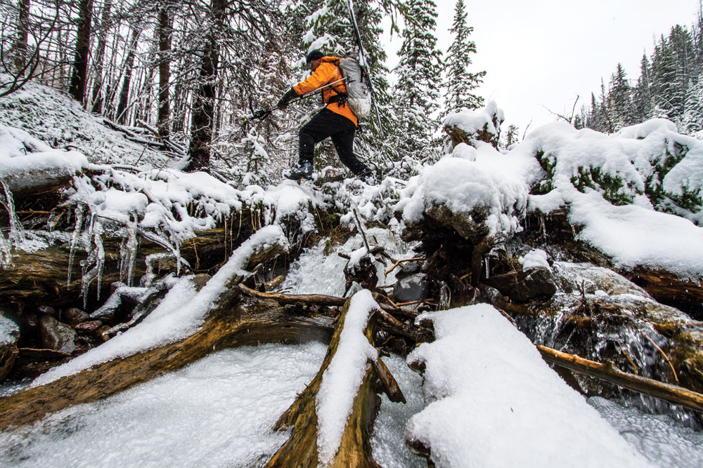 Covered in wet snow, slick rocks and fallen timber are nearly as treacherous as the avalanche prone slopes above.