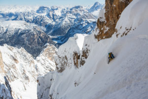 Bibi Pekarek drops in to a chute in the Dolomites. Photo Jim Harris