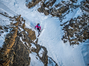Kate Hoiurihan entering the Hallway Couloir, Wasatch Backcountry. Photo Tobias MacPhee