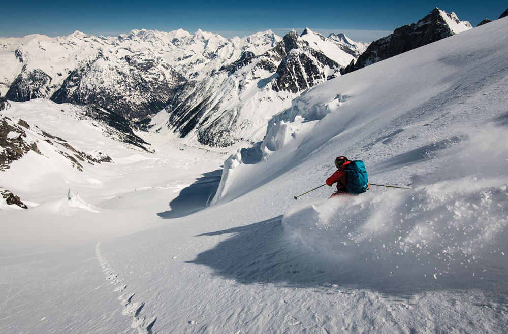 Greg testing out the snowpack on his way down from Proteus Peak. Stability looks to be cold and powdery.