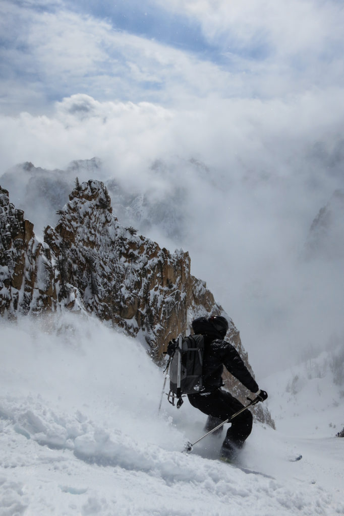 Dropping into the Iliad Couloir from the Silver Saddle above the Bench Hut