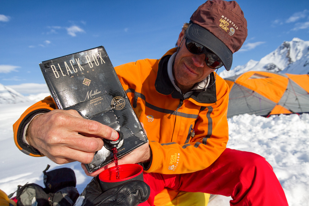 Andrew McLean pours and apres cocktail while expedition camping