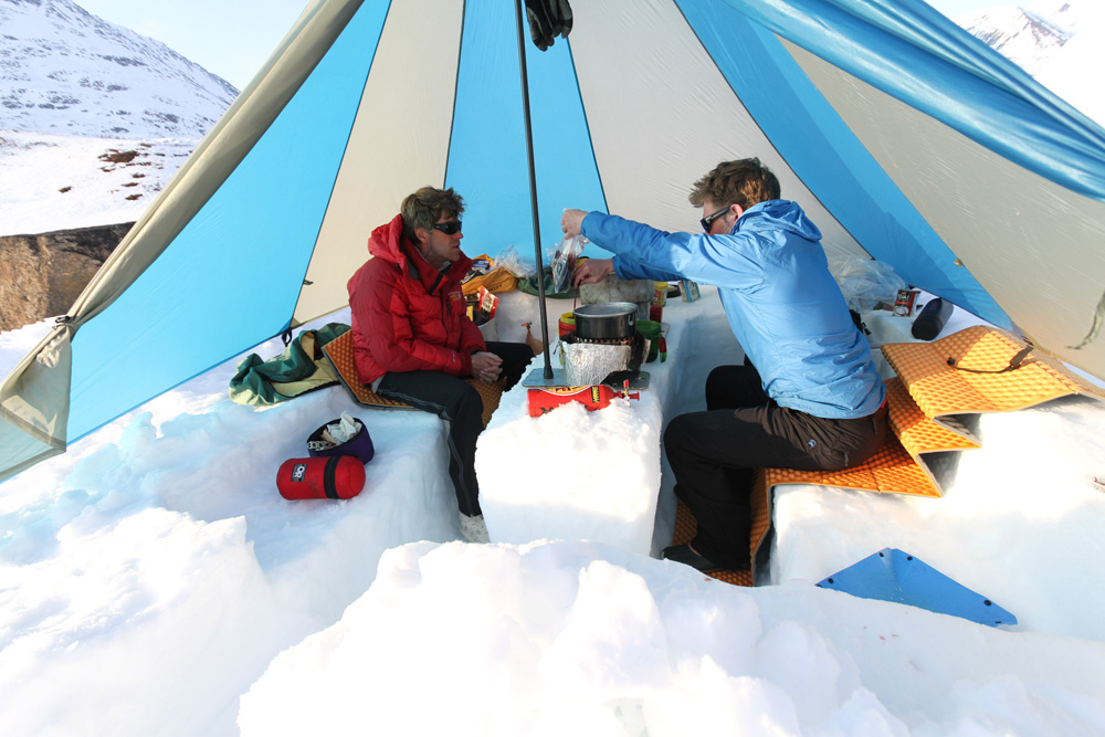 I'm pouring Andrew McLean another round from the box wine bag while snowcamping