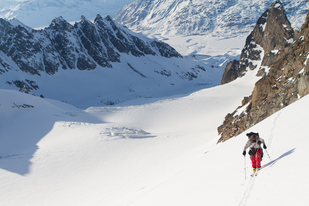 Andrew McLean skins up a glacier en route to the 4th big couloir of the day
