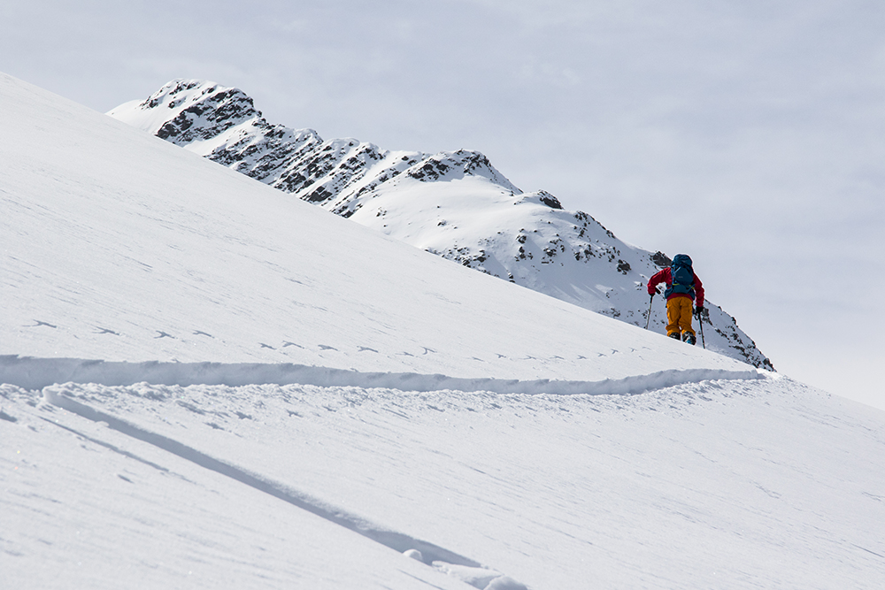 Sven Brunso skinning across teh valley from Disentis