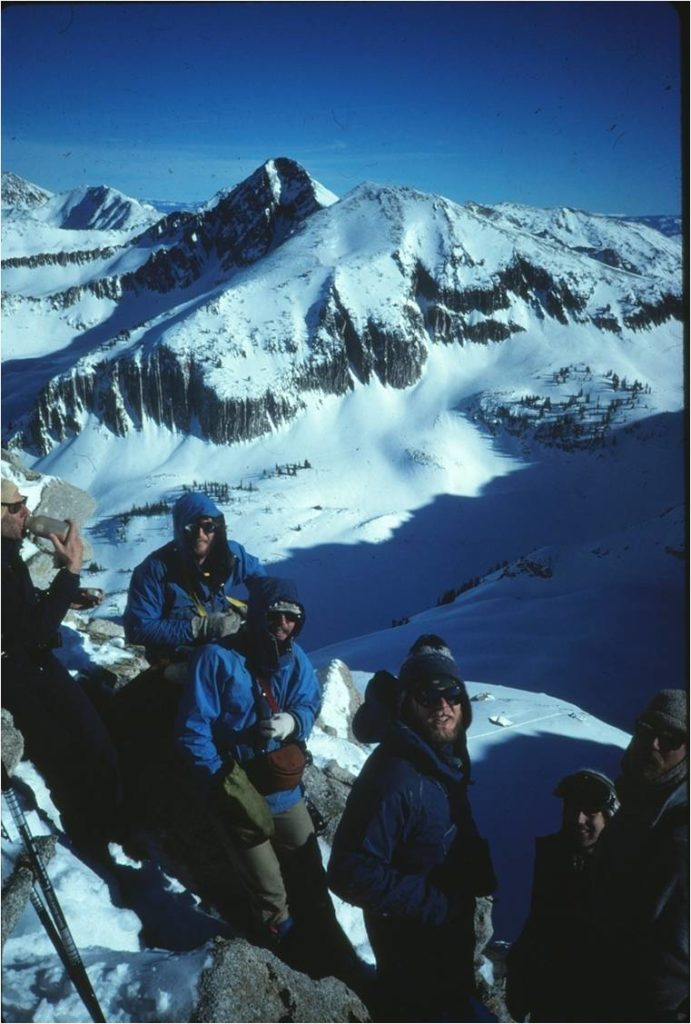 A touring party in front of the NW Couloir of the Pfeiifferhorn, Wasatch Range.
