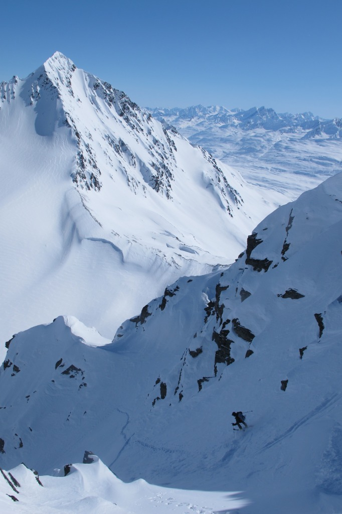 Mike Florance hop-turns in Cherry Couloir, with Tusk and Books terrain on right