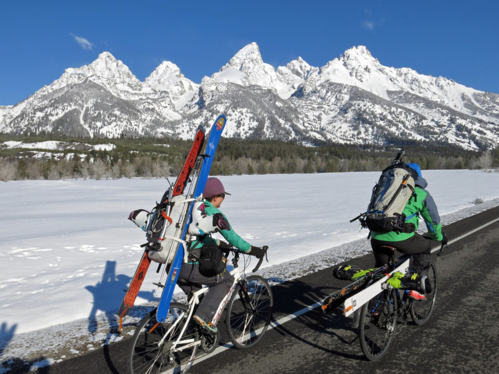 Pedaling through GTNP with a full ski kit, grinning from ear to ear.