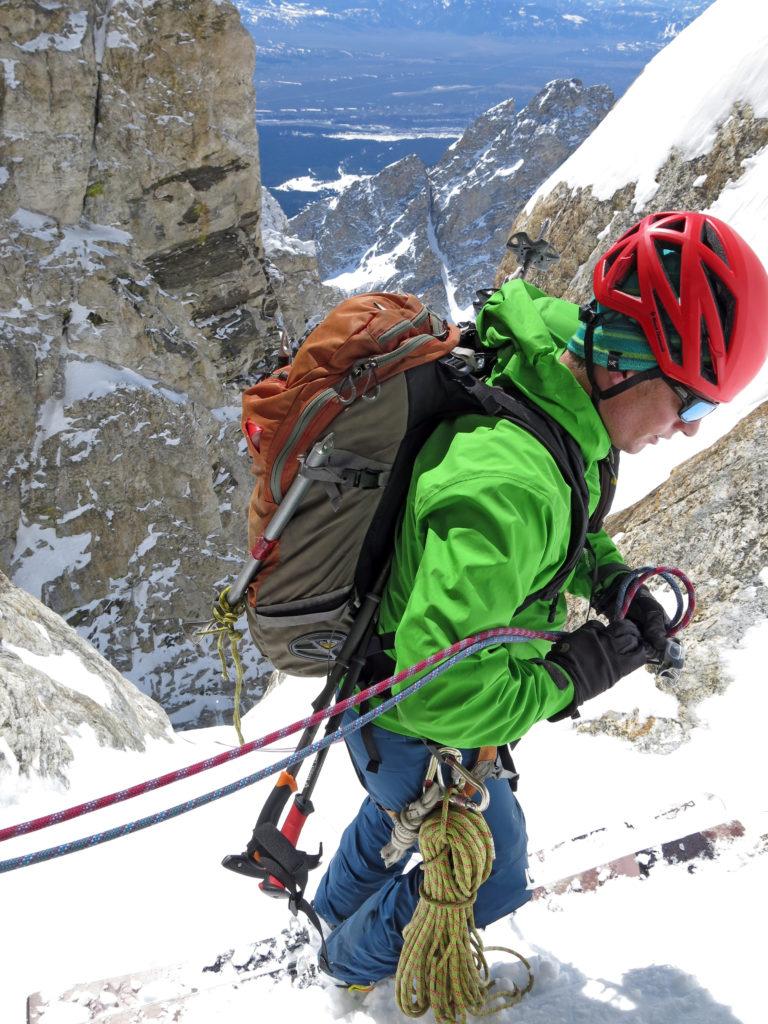 Jim Harris, rigging his rappel device, Grand Teton.