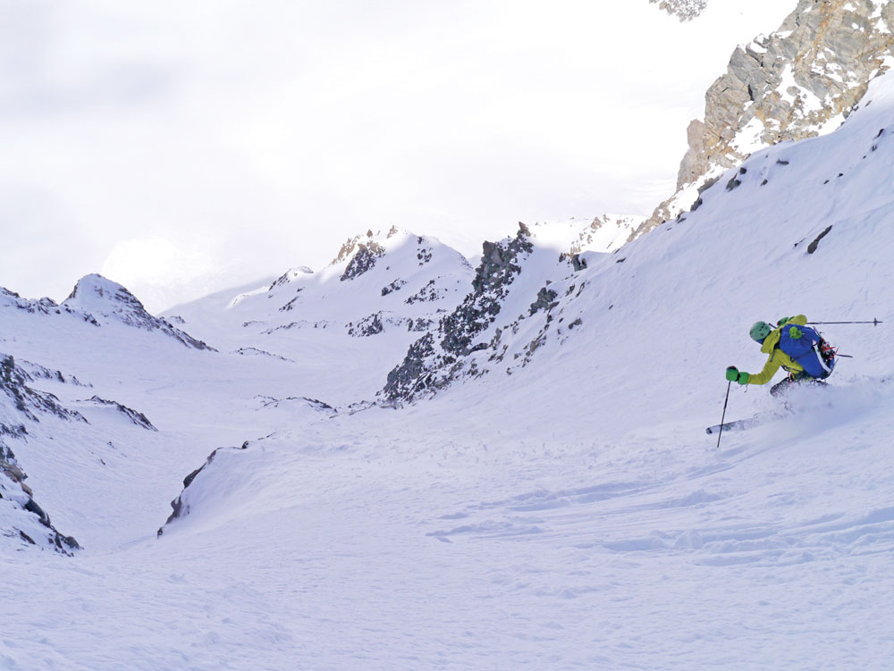Angling towards the crux on the SE Face of Cerro Bello, skier Adam Fabrikant.