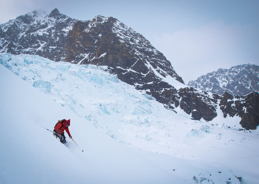 Ice flows to the right and the left, Laura opening it up on the apron of the Canadian Hunter Couloir.