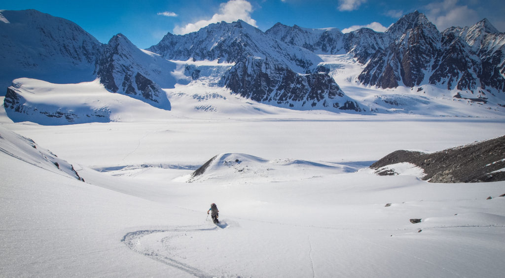 Breakable crust in Alaska still proves enjoyable. Laura skiing towards camp on the Mike Glacier, AK.