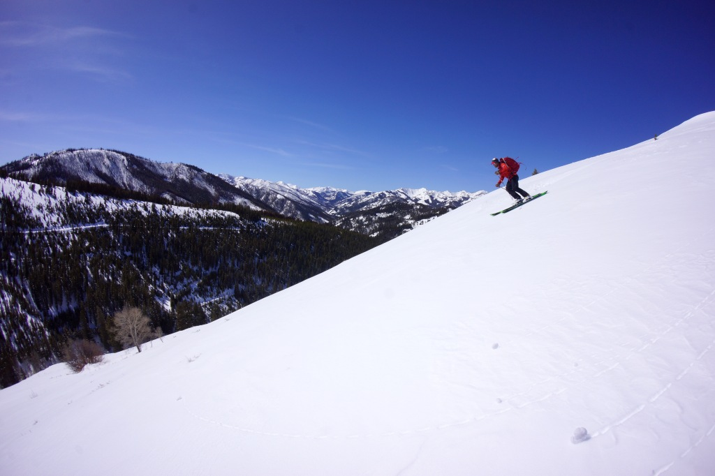 Patrick Graham skis the south facing corn, looking up to the head of Baker Creek.