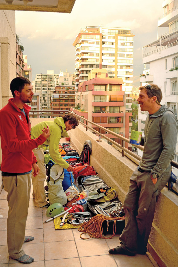 Billy, Adam, and Matt having a laugh while prepping for the trip on Diego's 9th floor terrazzo in Santiago.