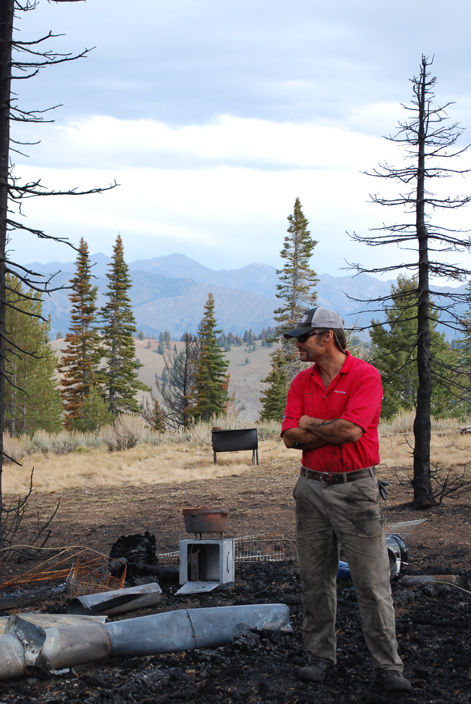 Joe St. Onge of Sun Valley Trekking surveys the burned Coyote Yurt site in 2013
