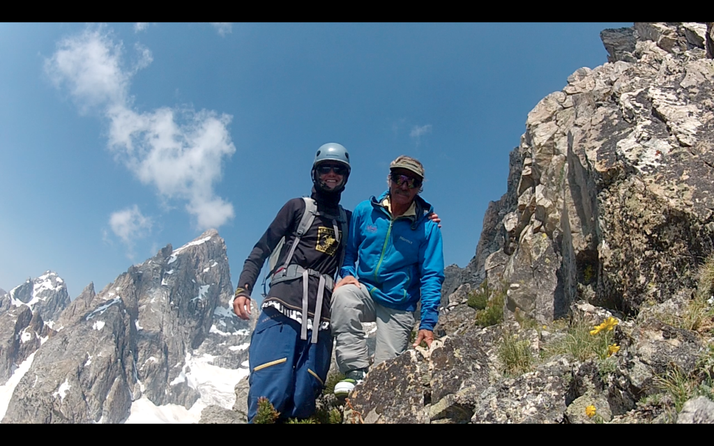 Hayden and Rick Wyatt on the flanks of Teewinot with the Grand Teton behind.
