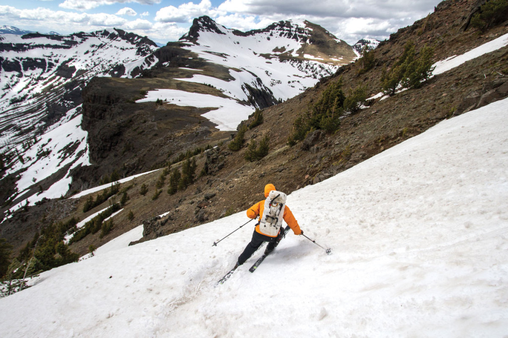 The northern Absaroka Range forms the watershed divide between the Boulder and Yellowstone Rivers. In the late spring, skiing along its crest requires connecting lingering snowfields.