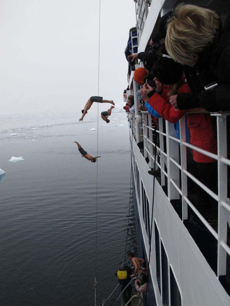 Taking the Polar Plunge off of the top deck into 32 degree Antarctic water.