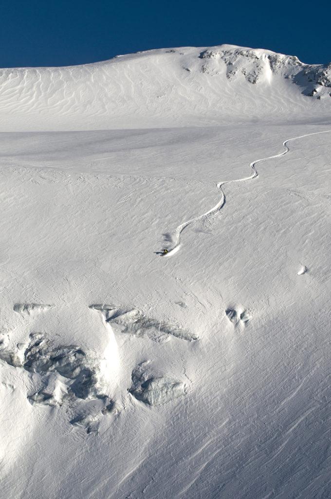 Dan Loutrel getting a last light run on the small glacier near the Grassen Bivouac