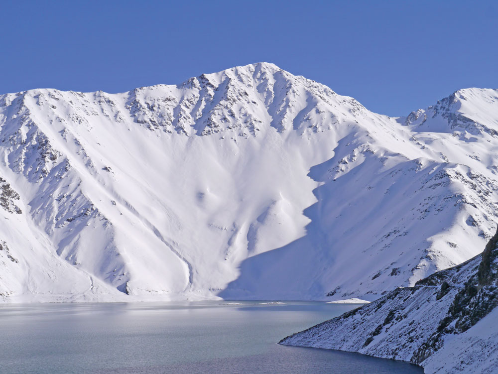 """Punta Yeso across the Embalse el Yeso: a 3600 ft. south facing """"low-hanging fruit"""" fall line shot in the Central Chilean Andes."""