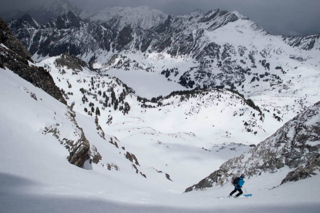 Max Taylor stops on the apron below the Y Couloir to take in the view.