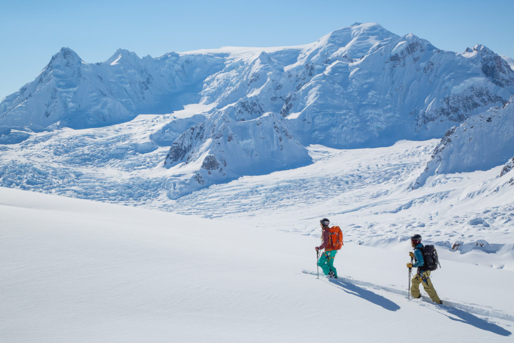 Zach and Cindi Grant breaking trail through fantastic conditions with the Capps Glacier in the background. Photo by Kelly Gray