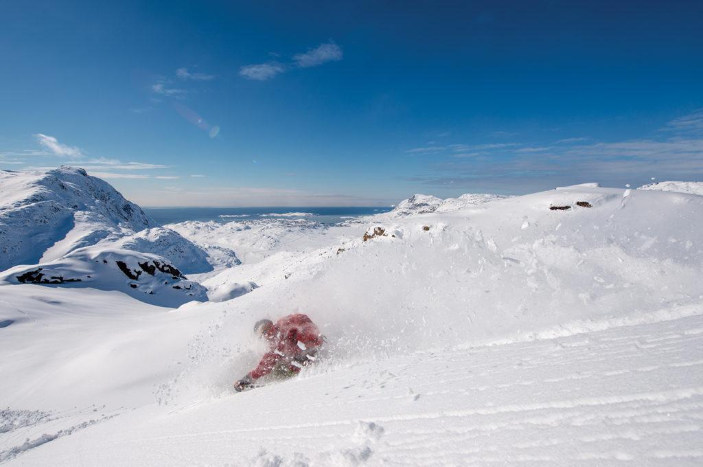 Brennan Lagasse deep in the polar powder. Photo Keoki Flagg