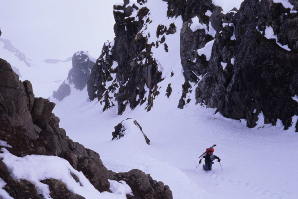 Booting up a chute in Iceland which would be filled with torrential avalanche debris about an hour later.