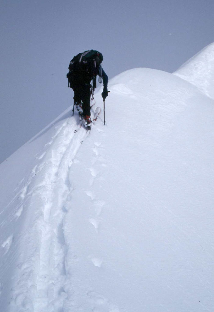 Lorne Glick pushing his way up a 35 degree ridge line in Alaska