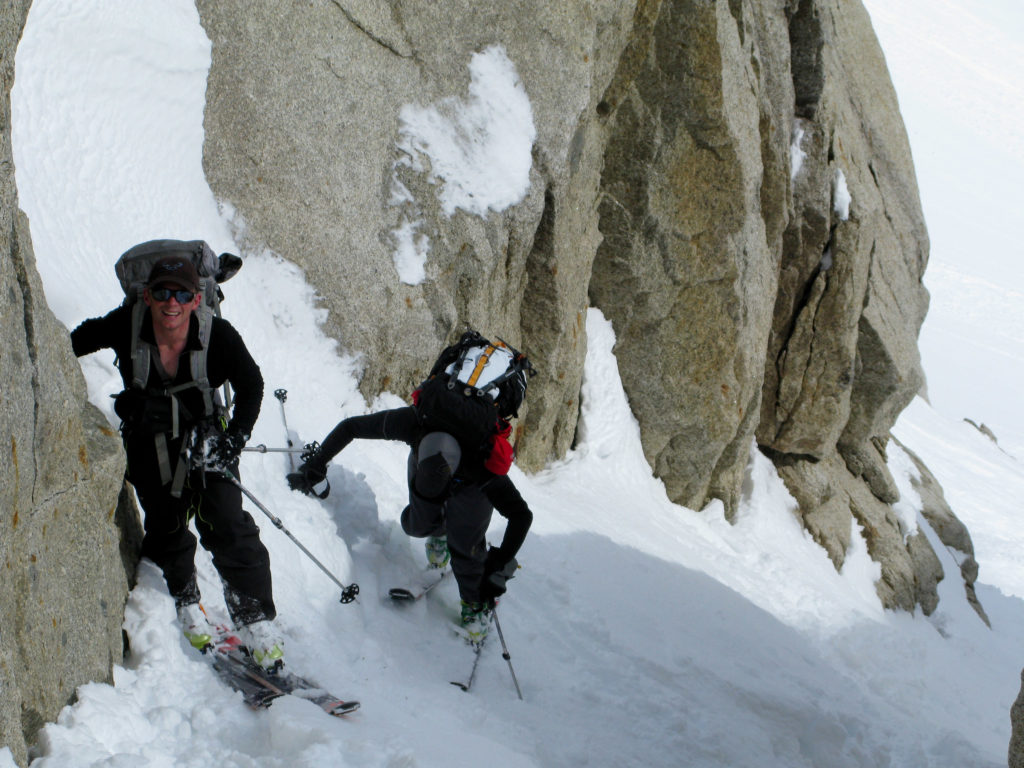 Jim Harris and Courtney Phillips switchbacking up a tight couloir.